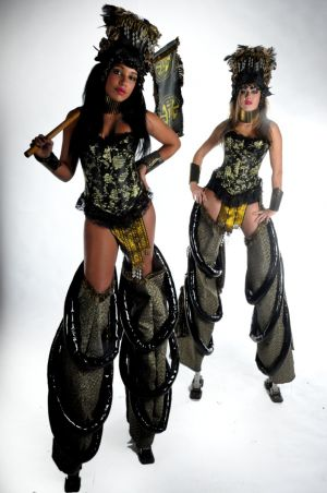Black And Gold Stilt Walkers