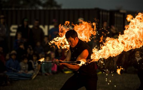 male fire staff performer