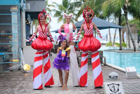 poolside stiltwalkers