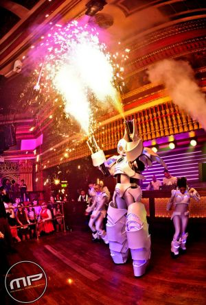 Robot And Dancers In Club