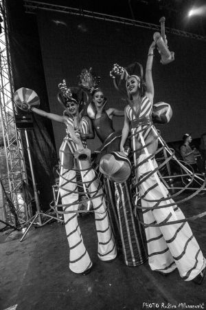 Stiltwalkers On Stage